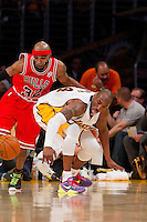 """25 December 2011: Guard Kobe Bryant of the Los Angeles Lakers knocks the ball away from Richard """"Rip"""" Hamilton of the Chicago Bulls during the second half of the Bulls 88-87 victory over the Lakers at the STAPLES Center in Los Angeles, CA."""