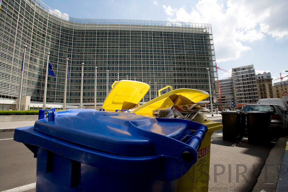 BRUSSELS - BELGIUM - 17 JUNE 2008 -- EU sets new recycling targets to be achieved by the Member States by 2020, including recycling rates of 50% for household and similar wastes and 70% for construction and demolition waste. Here recycling containers with paper and glass, plastics, metal and more. In the background the European Commission building, Berlaymont.  Photo: Erik Luntang/INSPIRIT Photo