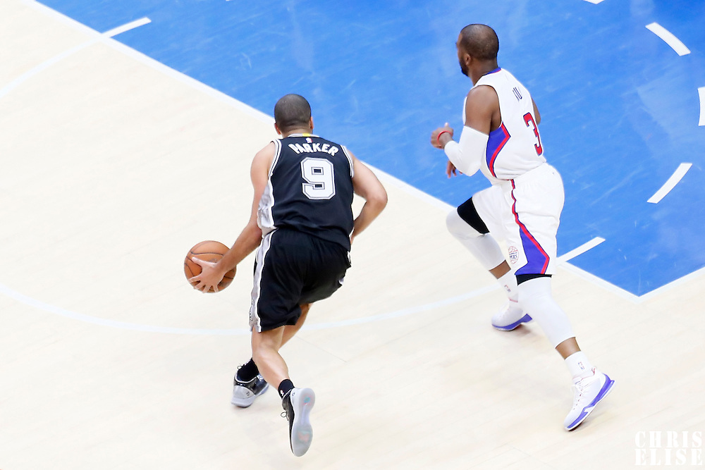 19 April 2014: San Antonio Spurs guard Tony Parker (9) drives past Los Angeles Clippers guard Chris Paul (3) during the Los Angeles Clippers 107-92 victory over the San Antonio Spurs, during Game One of the Western Conference Quarterfinals of the NBA Playoffs, at the Staples Center, Los Angeles, California, USA.