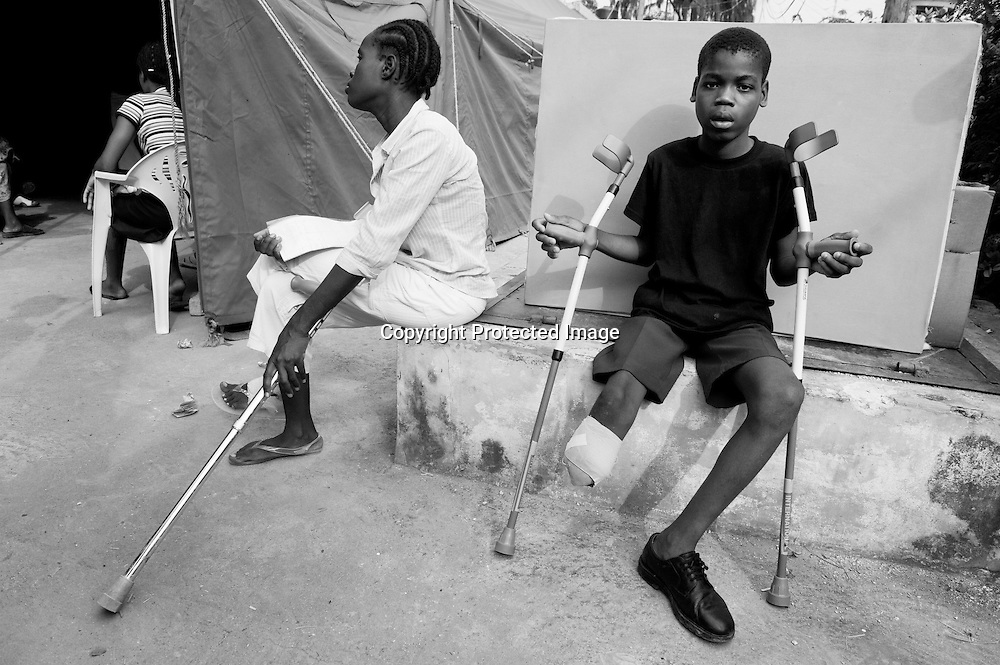 Evens Coriolane, 14, departs the Handicap International tent at General Hospital in Port-au-Prince with new braces. He was in his house when the quake hit and ran outside to save himself. Just as he reached the door, it was a neighbor's house that fell on him and crushed his leg under the rubble. It took his family ten days to find a hospital to care for him, but in the meantime the leg became infected and had to be amputated. At the time, he was in so much pain he couldn't sleep. Now, his father reports, he sleeps well. And he likes his new crutches.