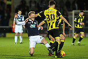 Millwall FC midfielder George Saville off the ground in a hard challenge on Burton Albion defender Tom Flanagan during the Sky Bet League 1 match between Burton Albion and Millwall at the Pirelli Stadium, Burton upon Trent, England on 1 December 2015. Photo by Aaron Lupton.