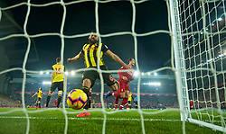 LIVERPOOL, ENGLAND - Wednesday, February 27, 2019: Liverpool's Virgil van Dijk celebrates scoring the fifth goal, his second of the game, as Watford's Adrian Mariappa kicks the ball in frustration during the FA Premier League match between Liverpool FC and Watford FC at Anfield. (Pic by Paul Greenwood/Propaganda)