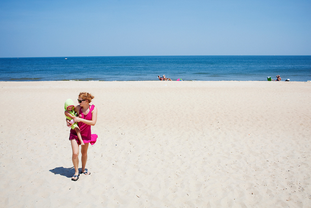 Melissa Eich and her daughter Madelyn, 2, leave the beach at Oceanview in Norfolk, Virginia on Saturday, July 24, 2010.