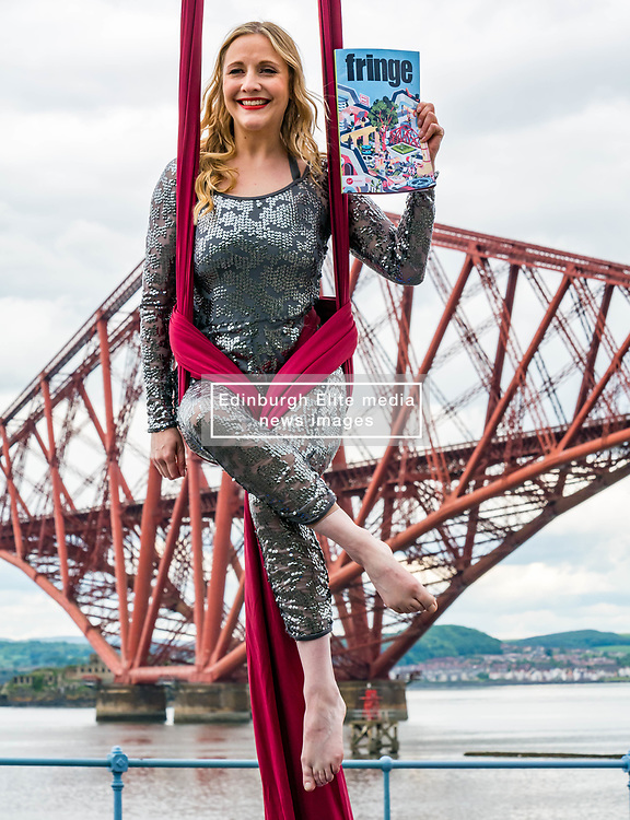 EMBARGOED TILL 10:00 5 JUNE 2019<br /> <br /> Pictured: Fringe Programme Launch. Forth Rail Bridge, South Queensferry, Scotland, United Kingdom, 04 June 2019. An aerial artist, Blaise Donald, wearing a sparkling costume performs in front of the iconic bridge launching the Edinburgh Festival Fringe programme and this year's Fringe hashtag #MakeYourFringe.<br /> <br /> Sally Anderson | EdinburghElitemedia.co.uk