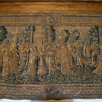 A tapestry on a wall at the Alcazar of Segovia commemorates the marriage of Ferdinand and Isabella.
