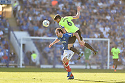 Portsmouth Forward, Brett Pitman (8) and Peterborough United Defender, Jack Baldwin (6) challenge for the ball during the EFL Sky Bet League 1 match between Portsmouth and Peterborough United at Fratton Park, Portsmouth, England on 5 May 2018. Picture by Adam Rivers.