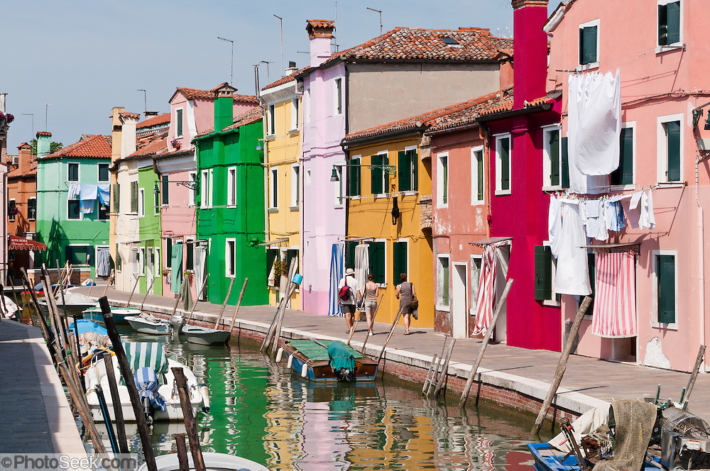 "Burano, known for knitted lacework, fishing, and colorfully painted houses, is a small archipelago of four islands linked by bridges in the Venetian Lagoon, northern Italy, Europe. Burano's traditional house colors are strictly regulated by government. The Romans may have been first to settle Burano. Romantic Venice, the ""City of Canals,"" stretches across 117 small islands in the marshy Venetian Lagoon along the Adriatic Sea in northeast Italy, Europe. Venice and the Venetian Lagoon are honored on UNESCO's World Heritage List."