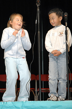 H:\Editorial\Photos\3 March 2006\JH 3-16-06 THEY'RE NO. 1-Lang Ranch Elementary School Geography Bee winners Emily Demsetz and David Huang celebrate after the recent geography challenge. The kids are second-graders and they competed with third-graders. Nice job, David and Emily!  . . ..