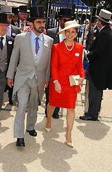 SHEIKH MOHAMMAD BIN RASHID AL MAKTOUM and his wife PRINCESS HAYA OF JORDAN at the first day of the Royal Ascot racing festival 2006 at Ascot Racecourse, Berkshire on 20th June 2006.<br />