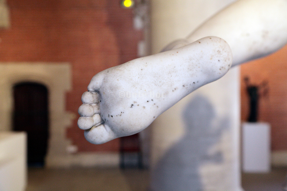 underside of feet of a classic marble statue