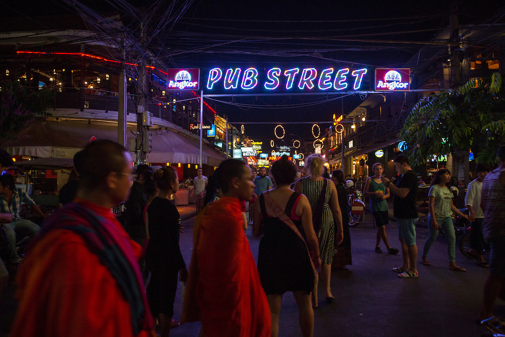 Buddhist monks walk amongst Western tourists along Pub Street in downtown Siem Reap, Cambodia, Asia. Siem Reap is the capital city of the Siem Reap Province.  Pub Street is a famous destination for lively nightlife for tourist and travellers.  (photo by Andrew Aitchison / In pictures via Getty Images)