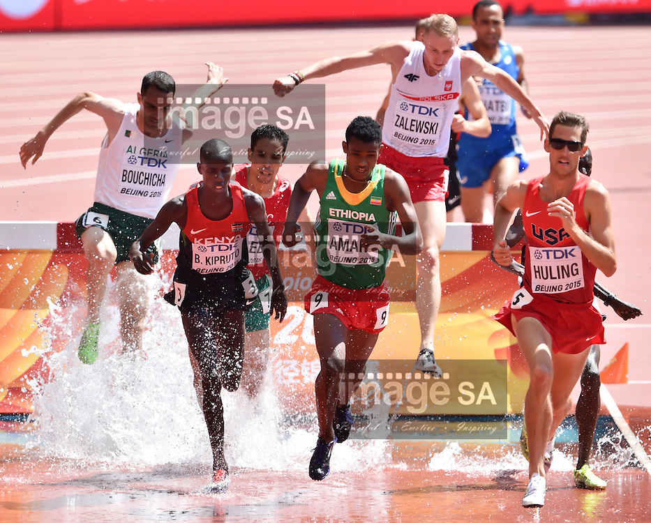BEIJING, CHINA - AUGUST 22: Brimin Kiprop Kipruto (Kenya), Hailemariyam Amare (Ethiopia) and Daniel Huling (USA) at the water jump in Round 1 of the mens 3000m steeplechase during day 1 of the 2015 IAAF World Championships at National Stadium on August 22, 2015 in Beijing, China. (Photo by Roger Sedres/Gallo Images)