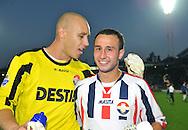 30-08-2008 Voetbal:Willem II: Ajax:Tilburg<br /> Maikel Aerts feliciteert de matchwinner Mehmet Akgun<br /> Foto: Geert van Erven