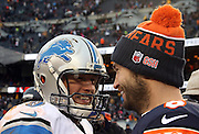 Detroit Lions quarterback Matthew Stafford (9) has a postgame laugh with Chicago Bears quarterback Jay Cutler (6) after the NFL week 17 regular season football game against the Chicago Bears on Sunday, Jan. 3, 2016 in Chicago. The Lions won the game 24-20. (©Paul Anthony Spinelli)