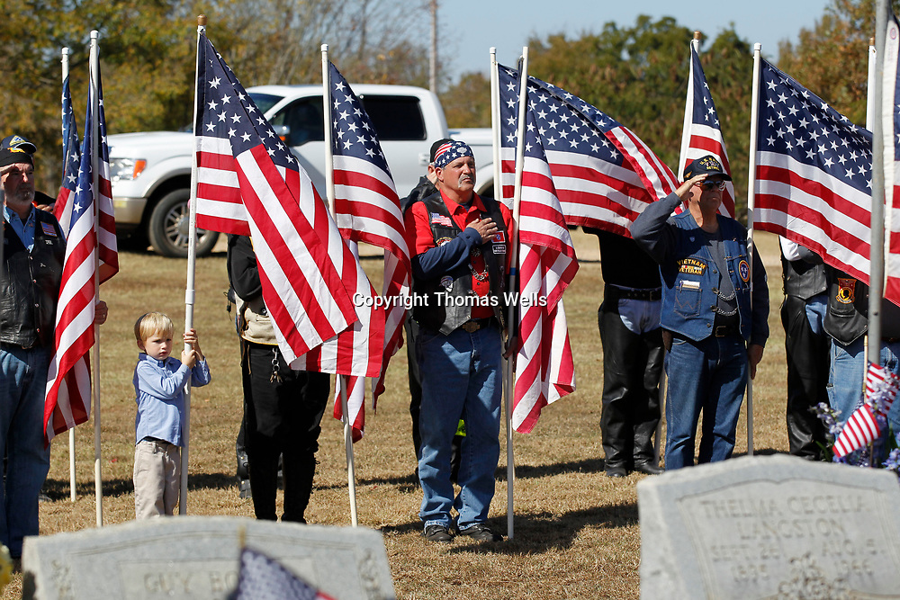 Bob Brock, 5, joins the Patriot Guard by helping hold an American flag to show his respect for Cpl. George Mason in 2015.