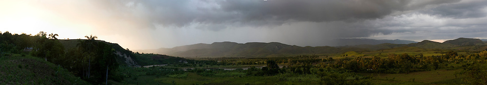 The Artibonite river and valley during sunset. Panorama made by combining several images.