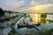Nederland, the netherlands, 11-6-2014Zicht op de waalkade en passantenhaven bij zonsondergang .Op de voorgrond het schip de opoe sientje wat tijdens de zomerfeesten het middelpunt vormt van cultureel festival de Kaaij . Foto: Flip Franssen