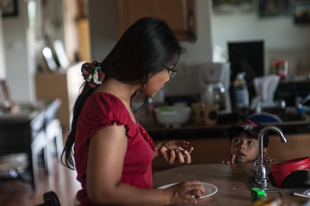 Ruby Faber explains to her son Trevor what type of berries were used in a homemade pie, Dulce, NM.
