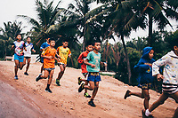 Young children, training for Muay Thai, have an early morning run in Rayong, Thailand.