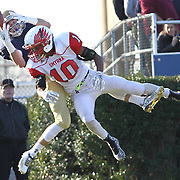 Salesianum split end Jeremy Ryan (5) catches a 11 yards  touchdown in the third quarter as Smyrna defensive back Jamal Powell (10) defends during a DIAA Division I championship game between Smyrna and Salesianum Saturday, Dec. 05, 2015 at Delaware Stadium in Newark.