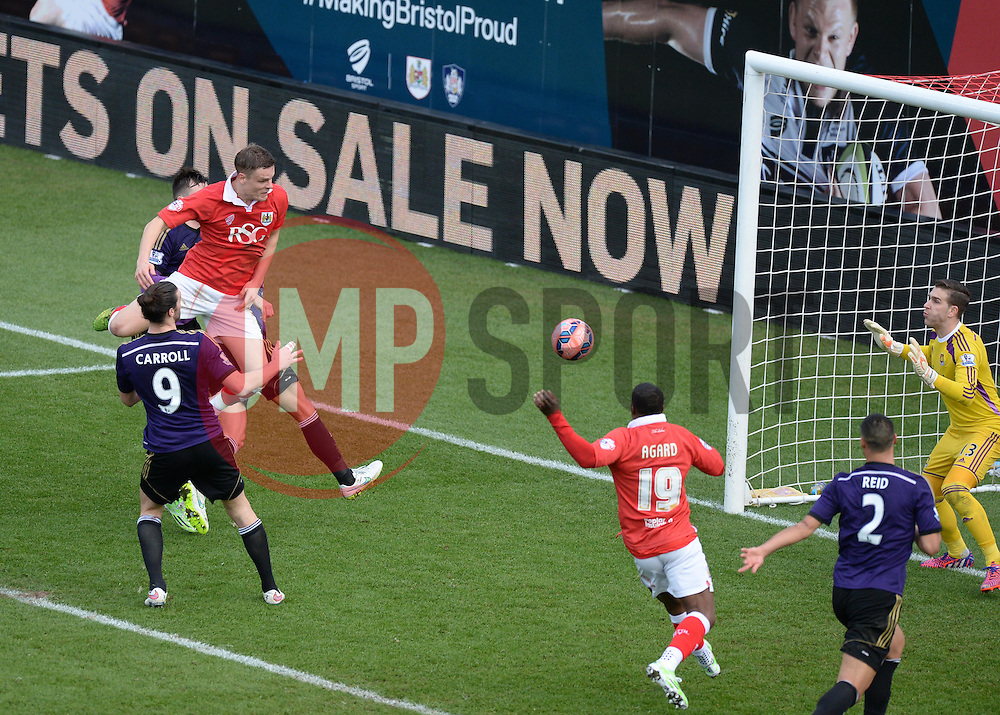 Bristol City's Matt Smith comes close with a header. - Photo mandatory by-line: Alex James/JMP - Mobile: 07966 386802 - 25/01/2015 - SPORT - Football - Bristol - Ashton Gate - Bristol City v West Ham United - FA Cup Fourth Round