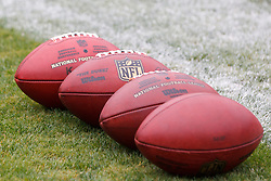 Sep 25, 2011; Oakland, CA, USA;  NFL footballs on the sidelines before the game between the Oakland Raiders and the New York Jets at O.co Coliseum. Oakland defeated New York 34-24.