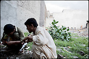 "Drug addicts during the daily consumption of heroin. Usually those people meet in the same places to share their doses. Morgh Mandi in Rawalpindi, Pakistan, on thursday, August 14 2008.....""Pakistan is one of the countries hardest hits by the narcotics abuse into the world, during the last years it is facing a dramatic crisis as it regards the heroin consumption. The Unodc (United Nations Office on Drugs and Crime) has reported a conspicuous decline in heroin production in Southeast Asia, while damage to a big expansion in Southwest Asia. Pakistan falls under the Golden Crescent, which is one of the two major illicit opium producing centres in Asia, situated in the mountain area at the borderline between Iran, Afghanistan and Pakistan itself. .During the last 20 years drug trafficking is flourishing in the Country. It is the key transit point for Afghan drugs, including heroin, opium, morphine, and hashish, bound for Western countries, the Arab states of the Persian Gulf and Africa..Hashish and heroin seem to be the preferred drugs prevalence among males in the age bracket of 15-45 years, women comprise only 3%. More then 5% of whole country's population (constituted by around 170 milion individuals),  are regular heroin users, this abuse is conspicuous as more of an urban phenomenon. The substance is usually smoked or the smoke is inhaled, while small number of injection cases have begun to emerge in some few areas..Statistics say, drug addicts have six years of education. Heroin has been identified as the drug predominantly responsible for creating unrest in the society."""