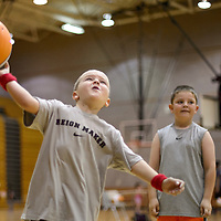 060314       Cayla Nimmo<br /> <br /> Tucker Matkovich tries to shoot the ball during Basketball Camp at Gallup High School Tuesday morning.