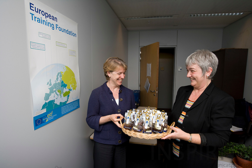 BRUSSELS - BELGIUM - 5 SEPTEMBER 2008 -- Marleen VOORDECKERS, European Training Foundation Brussels liaison officer, offering her director Dr. Myriel DUNBAR (Le) Belgium chocolate at the small opening of the foundations new liaison office in the EU Commission building Tour Madou.  -- Photo Erik LUNTANG / EUP-Images