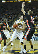 December 04 2010: Iowa Hawkeyes forward Andrew Brommer (20) drives in the lane by Idaho State Bengals center Deividas Busma (33) during the first half of their NCAA basketball game at Carver-Hawkeye Arena in Iowa City, Iowa on December 4, 2010. Iowa won 70-53.