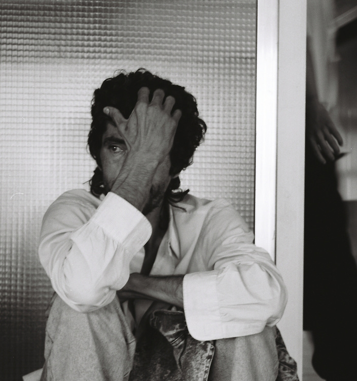 A man waits for a bus at the bus station in Estepona, Spain, 1997.
