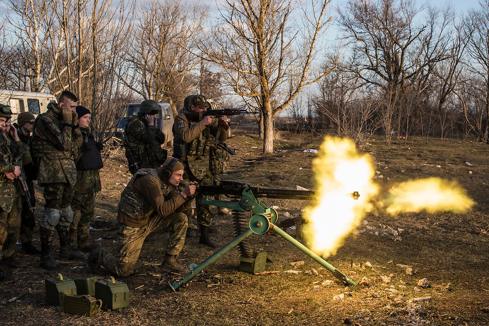 Members of the Azov Brigade fire a DshK heavy machine gun during weapons training at one of the group's training grounds on Saturday, March 7, 2015 in Kulykivske, Ukraine. Photo by Brendan Hoffman, Freelance