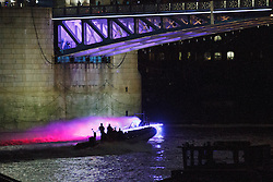 © Licensed to London News Pictures. 25/07/2012. London, UK. A colourful illuminated boat passes under Tower Bridge in London on 24 July 2012 in a rehearsal event believed to be related to the opening ceremony of the 2012 Olympic Games. Photo credit : Vickie Flores/LNP
