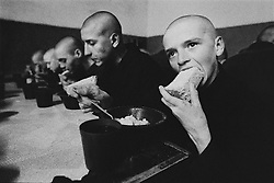 Russian juvenile prisoners eat their bread and porridge during supper at the colony for prisoner's children in Siberian town Leninsk-Kuznetsky, Russia, 26 January 2000.