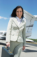 Businesswoman Beside an Airplane