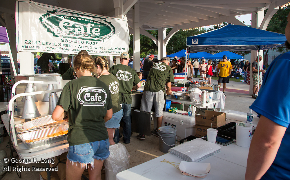 The Abita Springs Cafe serves food as people gather in Abita Springs Park before fireworks on July 2, 2017