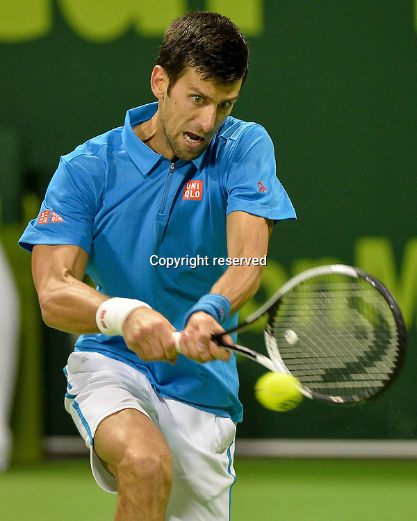 07.01.2017. Doha, Qatar. Novak Djokovic of Serbia returns to Andy Murray of Britain during the men's singles final of the ATP Tennis Herren Qatar Open tennis tournament at the Khalifa International Tennis Complex in Doha.