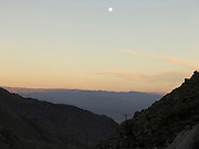 mountain range with moon at sunset USA