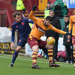 Connor Randall (Hearts) and Nadir Ciftci (Motherwell) during the Scottish Cup quarter final between Motherwell and Hearts at Fir Park, where the home side made it into the semi final draw with a win.<br /> <br /> <br /> (c) Dave Johnston | sportPix.org.uk