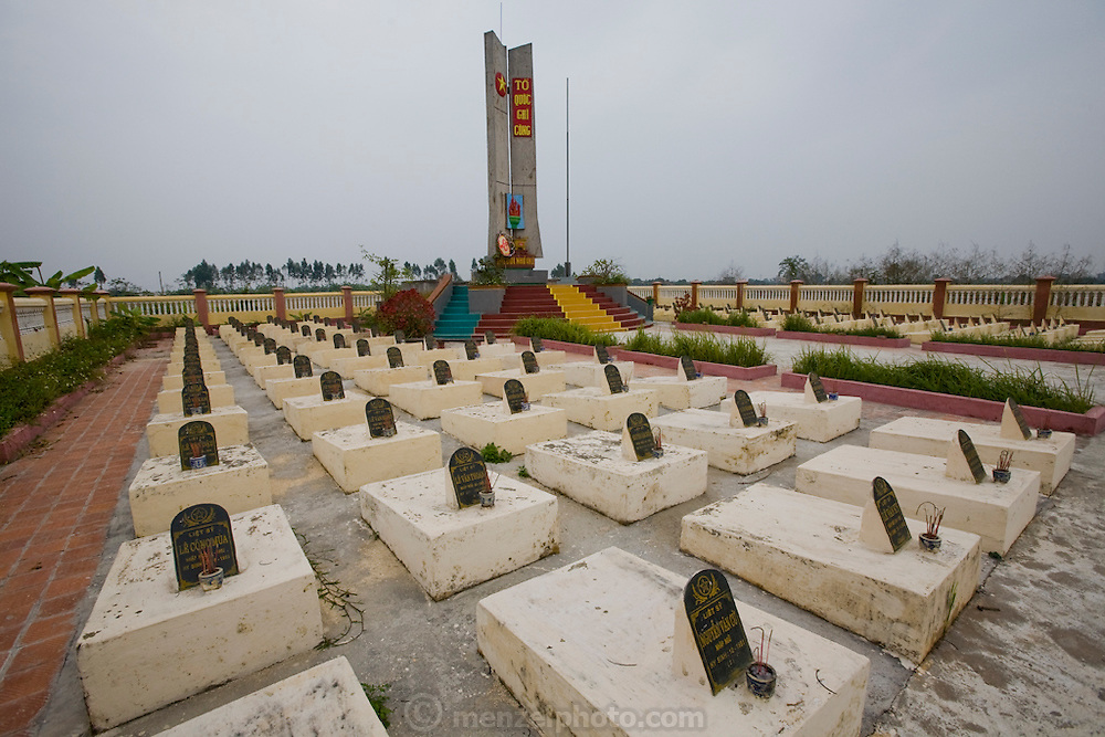 The War Memorial Cemetery in a rural village (one of thousands) near the home of rice farmer Nguyen Van Theo, featured in the book What I Eat: Around the World in 80 Diets. Nearly every village has a war memorial cemetery for the millions who died during decades of war with the French, Americans, South Vietnamese, and Chinese.