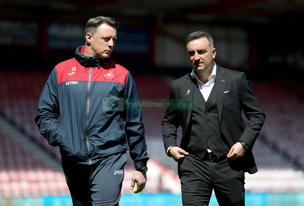 Swansea City manager Carlos Carvalhal (right) and goalkeeping coach Tony Roberts inspect the pitch before the Premier League match at the Vitality Stadium, Bournemouth.