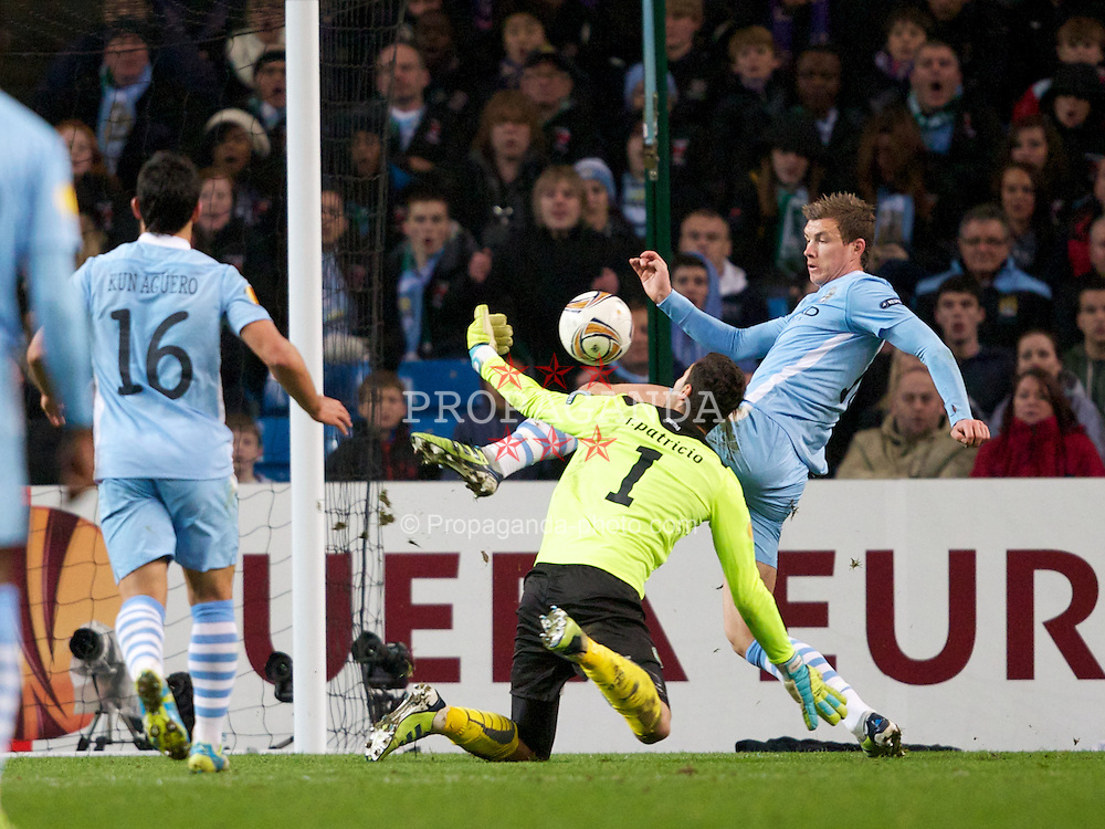 MANCHESTER, ENGLAND - Thursday, March 15, 2012: Manchester City's Edin Dzeko in action against Sporting Clube de Portugal's goalkeeper Rui Patricio during the UEFA Europa League Round of 16 2nd Leg match at City of Manchester Stadium. (Pic by Vegard Grott/Propaganda)