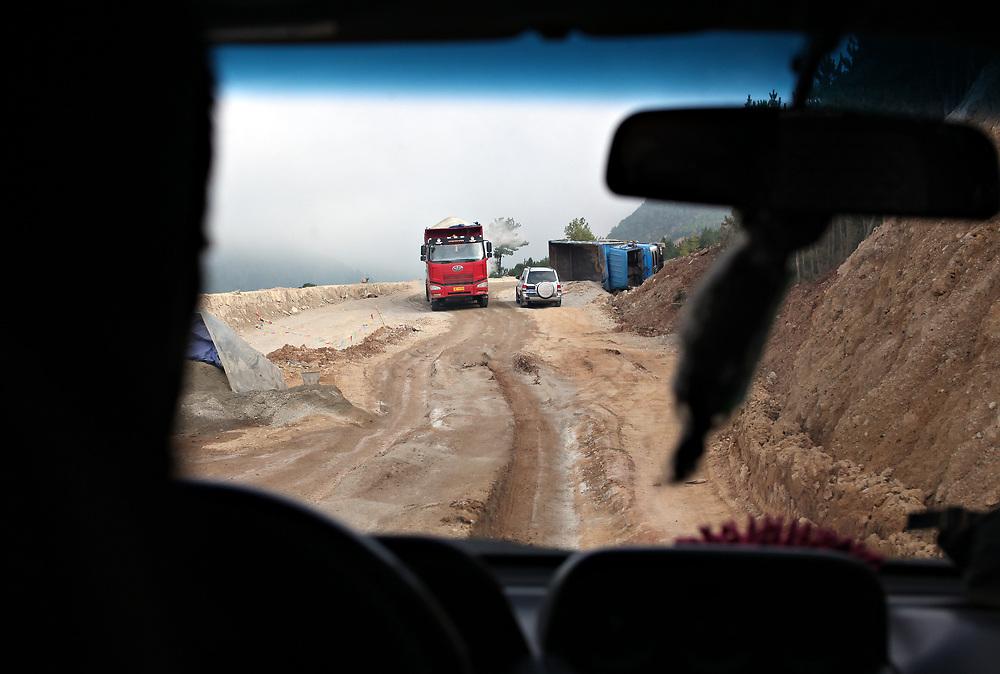 Rough roads (Highway 214) north of Shangri-la, Yunnan, China; September, 2013.