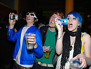 Group of new ravers taking photographs, CSS gig, February 2007