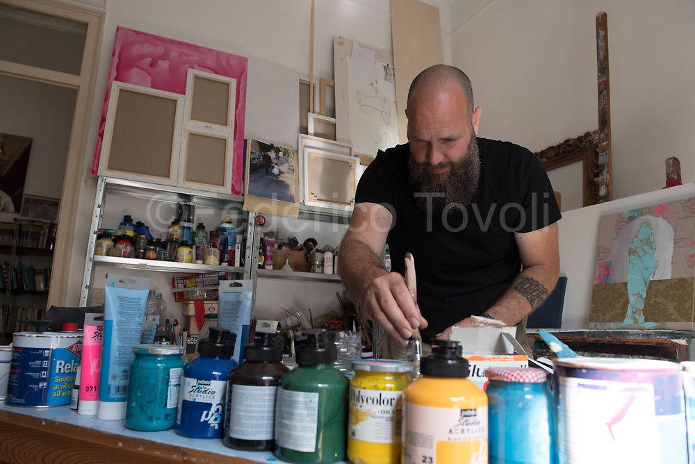 The artist Igor Scalisi Palminteri in his home studio