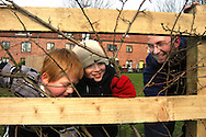 Residents & children volunteer to plant trees on housing association estate; Leeds Yorkshire UK