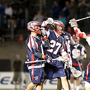 Members of the Boston Cannons celebrate a goa during the game at Harvard Stadium on May 10, 2014 in Boston, Massachusetts. (Photo by Elan Kawesch)