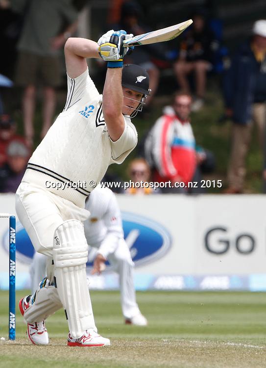 Jimmy Neesham plays a shot.  First day, second test, ANZ Cricket Test series, New Zealand Black Caps v Sri Lanka, 03 January 2015, Basin Reserve, Wellington, New Zealand. Photo: John Cowpland / www.photosport.co.nz