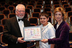 PRESS RELEASE FROM MENTAL HEALTH IRELAND.. .DONEGAL STUDENT  IS RUNNER UP IN NATIONAL.ART PROJECT. .Aaron Boyle, a student at St. Columba's Comprehensive School, Glenties, Co Donegal was declared runner-up of Mental Health Ireland's national Design-a-Cover Project at a ceremony in Trinity College, Dublin, on Saturday (April 9th, 2011)...Pictured was Mental Health Ireland, Chief Executive Officer, Brian Howard with Aaron Boyle, St Columba's Comprehensive School, Glenties, Co. Donegal and his Teacher Ms. Miriam Flynn....Aaron's design, which was chosen from over one thousand entries received from second-level students from all over Ireland, will be used by Mental Health Ireland in their Annual Calendar 2012. The theme of the Project was Positive Mental Health.  Aaron was presented with his award, a trophy, by Mr Michael Hughes, Chairman of Mental Health Ireland.  ..Aaron's picture shows four figures standing on pieces of Jigsaw. One piece is separated from the others but the figures are reaching out to each other symbolic of support for the figure adrift. The caption reads ?All we need (is) a helping hand?. Thérèse Coveney of Mental Health Ireland said ?The judges loved Aaron's picture. The hand reaching out for help depicts Positive Mental Health in a very simple and effective way?....The winner of the 2010-2011 National Public Speaking event, which drew nearly 200 entries from schools and colleges nationwide, was also decided on Saturday night. This year's winning team is from Summerhill College, College Rd., Sligo who faced teams from Athlone Community College, Athlone, Co. Westmeath and Coláiste Eoin, Hacketstown, Co. Carlow in the national finals.. .- ENDS -. Note to Editors: Mental Health Ireland is a national voluntary organisation which aims to promote positive mental health and to actively support persons with a mental illness, their families and carers by identifying their needs and advocating their rights. A nationwide network of Mental Health Associations