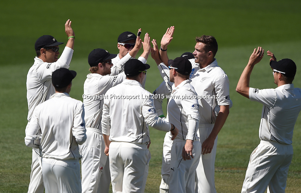 Tim Southee celebrates with team mates after Latham takes a catch to dismiss on day 2 of the 2nd cricket test match between New Zealand Black Caps and Sri Lanka at Seddon Park in Hamilton, New Zealand. Saturday 19 December 2015. Copyright photo: Andrew Cornaga / www.photosport.nz